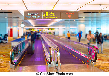Singapore airport travelator - People at travelator in the...