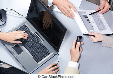 Explaining - Close-up of businesspeople hands over workplace...