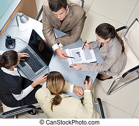Working team - Above view of executive people interacting at...