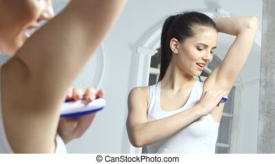 Girl shaves the epilator at her armpits, she's very happy -...