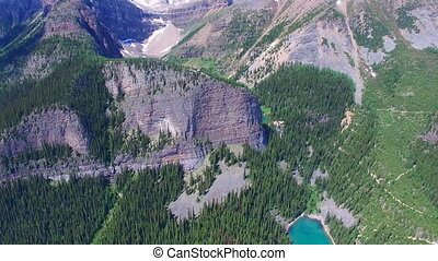 Banff park Alberta aerial - Flying over beautiful mountain...