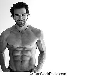 Sexy shirtless man - Sexy smiling shirtless man against...