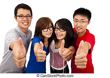Four young teenagers laughing and giving the thumbs-up