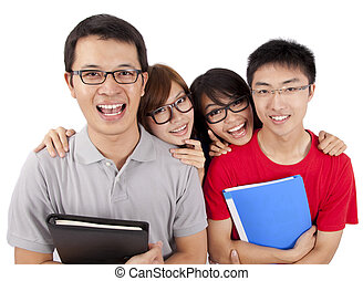 Four happy students standing together with fun, while smiling and looking at camera isolated on white background.