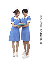 Two Nurses team reading on clipboard and isolated on the...