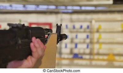 Boy teenager shoots in a dash from the machine gun. Airguns...