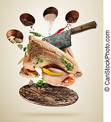 Whole raw chicken with ingredients, food preparation concept...