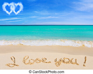 Words I Love You on beach and connected hearts clouds