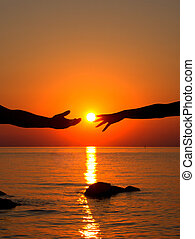 Hands in love in the setting sun