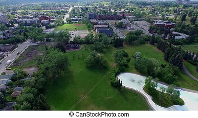 Aerial shot park Calgary Alberta - Zooming out park summer...