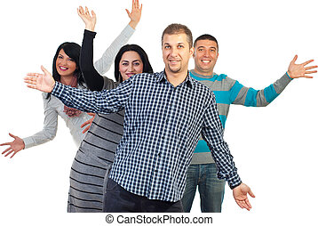 Cheerful group of friends standing with arms open isolated...