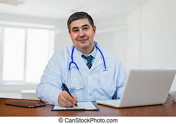 A male doctor works in a medical center