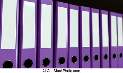 Multiple purple office binders. Loopable motion background