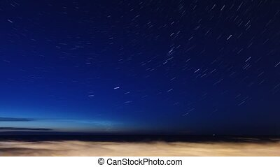 Moving stars trails at night sky