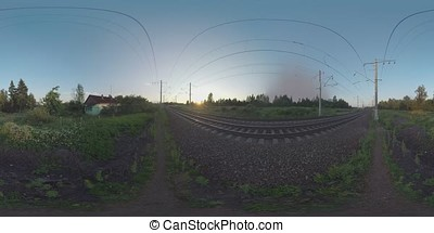 360 VR Train moving across the countryside at sunset....