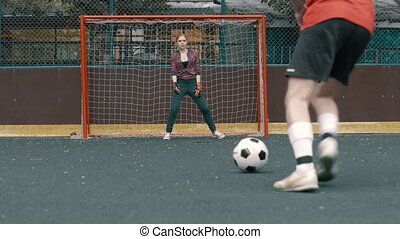 Female football goalkeeper stands at gate. Goal to yourself....