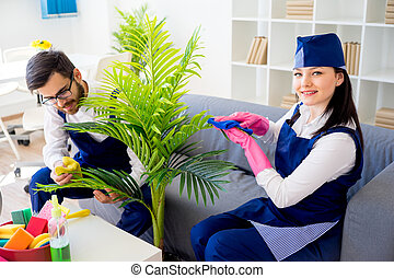 Two cleaning service workers
