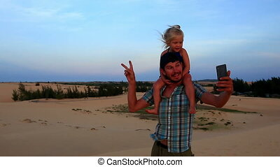 Closeup Father Carries Small Girl on Dune Makes Selfie at...