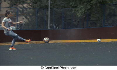 Female soccer player beats ball with foot. Woman soccer...