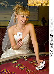 happy bride playing cards in a casino