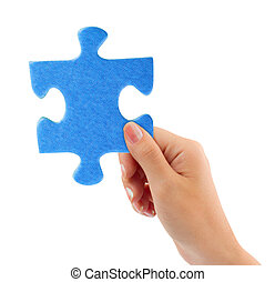 Hand with puzzle