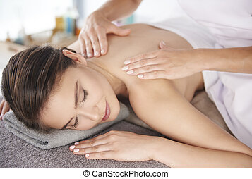 Beautiful woman resting at the spa