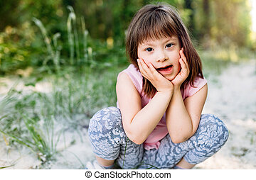 Portrait of young girl with down syndrome - Portrait of...