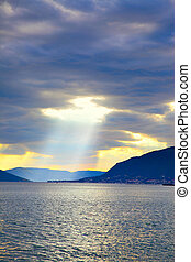 Water landscape with sunbeam, Boka Kotorska bay, Montenegro....
