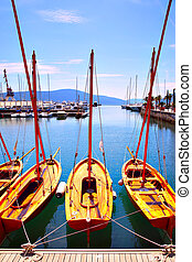 Boats on the berth - Wooden sail boats on the berth