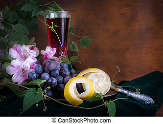 Glass of wine, pink flowers, grapes and lemon - Still life...