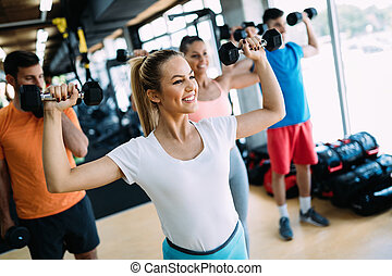 Group of people training together in gym