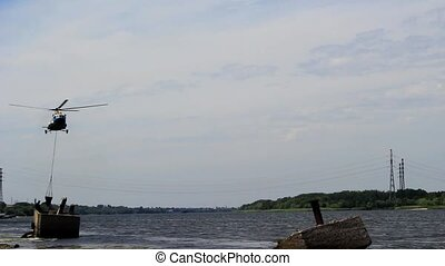 Helicopter with a ladle over the river - A fire helicopter...