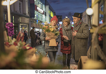 Friends Shopping The Christmas Market - Mature friends are...