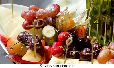 fruit on table grape pear cherry - fruit plate on a festive...