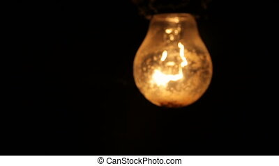 Electric light bulb on a black background - Old light...