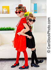 two little fashion-mongers - Two funny little girls with...