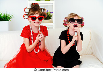 party for children - Two funny little girls with curlers in...