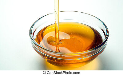 Still life of fresh honey on a white background - fresh...