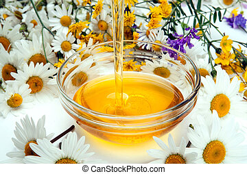 Still life of fresh honey and flowers - fresh honey flows...