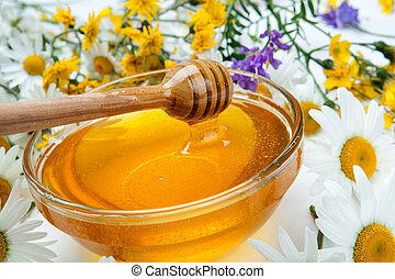 Still life of fresh honey and flowers - fresh honey in the...