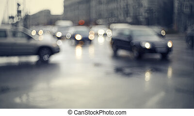 Blurry unfocused background with the city road with cars in...