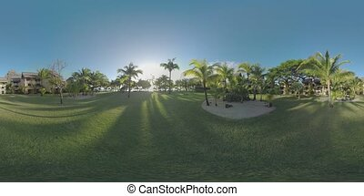 360 VR Tropical resort area with hotels palms and green...