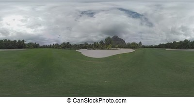 360 VR Scene of green empty golf course with palms around,...