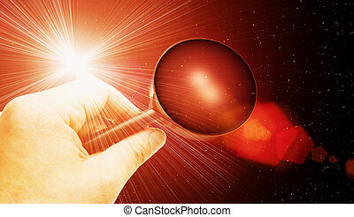 cosmos underground - hand with magnifying glass searching...