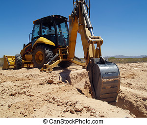 Digging the footings 4 - A construction Back Hoe digging the...