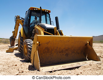 Digging the footings 2 - A construction Back Hoe digging the...