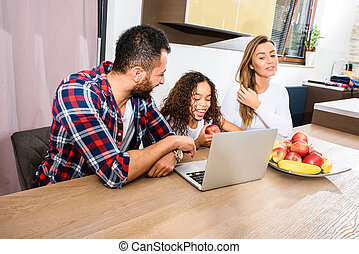 Young family sitting at the table