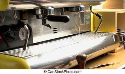 Male hand and coffee machine. Coffee maker pouring hot...