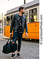Young hipster man next to the tramline - A handsome young...