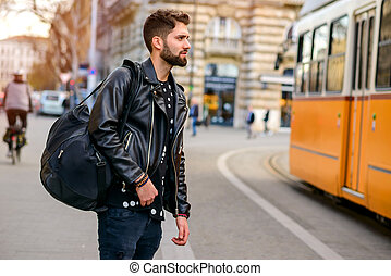 Young man next to the tramline - A handsome young hipster...
